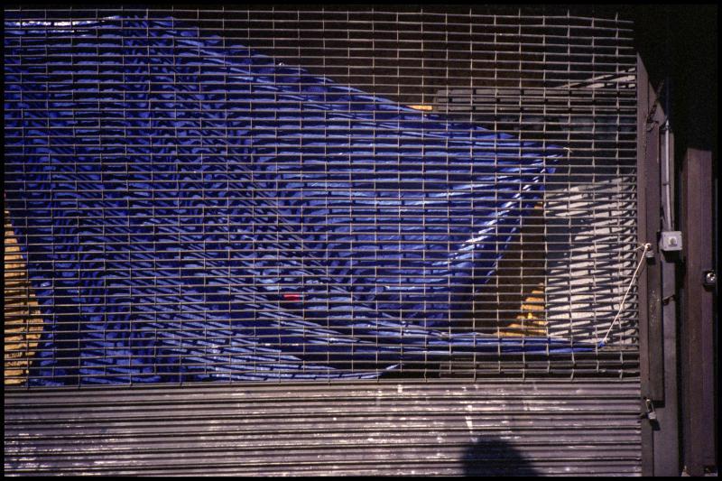 Gate and Blue Tarp