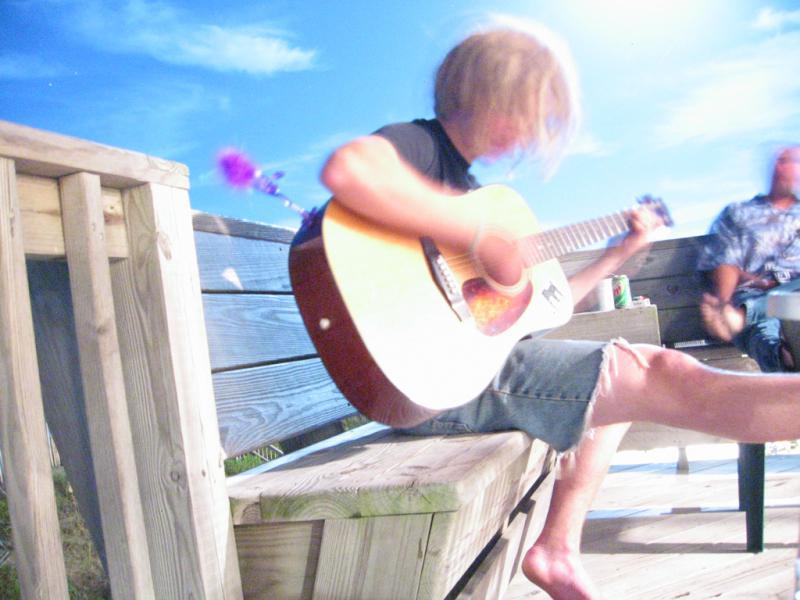 John Ryan playing Guitar